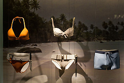 © licensed to London News Pictures. London, UK 05/07/2012. Bond Girl bikinis and a Bond swimwear being shown with many Bond items which have been used in the movies in the last 50 years at Designing 007 exhibition at Barbican Centre. Photo credit: Tolga Akmen/LNP