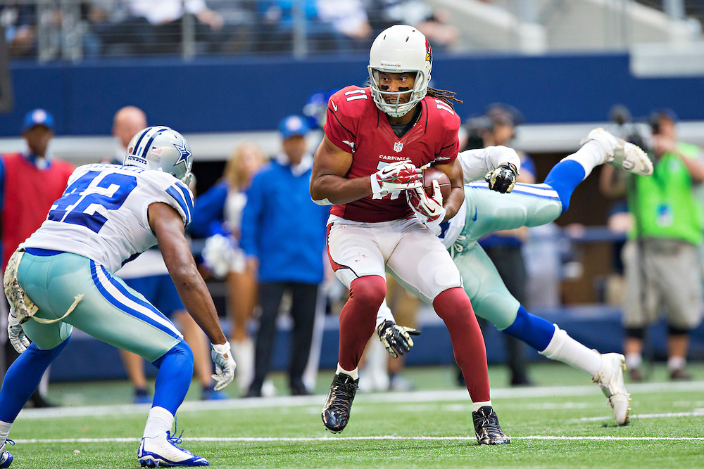 ARLINGTON, TX - NOVEMBER 2:  Larry Fitzgerald #11 of the Arizona Cardinals is tackled in the third quarter by Barry Church #42 of the Dallas Cowboys at AT&T Stadium on November 2, 2014 in Arlington, Texas.  The Cardinals defeated the Cowboys 28-17.  (Photo by Wesley Hitt/Getty Images) *** Local Caption *** Barry Church; Larry Fitzgerald