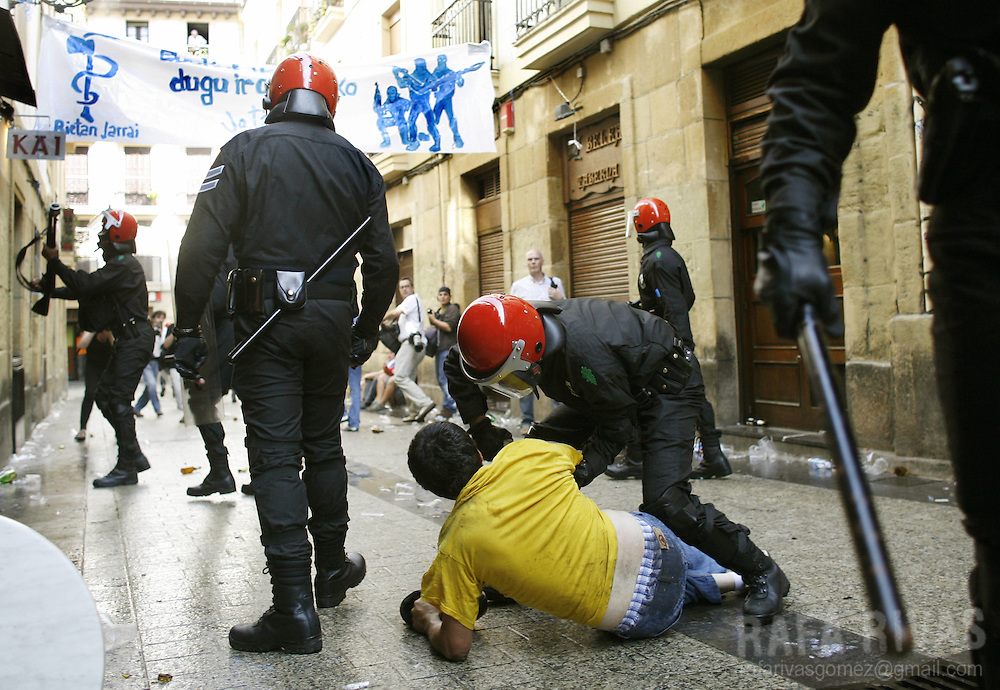 A man is arrested by Ertzaintza (Basque regional Police)during an illegal demonstration in favour of separatist armed Basque terrorist group ETA prisoners called by pro ETA imprisoned members group Askatasuna (Freedom in Basque), 09 September 2007, in the northern Spanish Basque town of Donostia-San Sebastian. PHOTO RAFA RIVAS