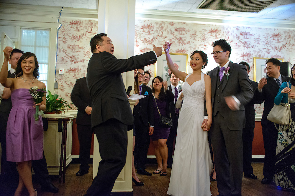 "Photo by Matt Roth.Assignment ID: 30140754A..Father of the bride Paul Hsieh raises an ""invisible glass"" to toast the new bride and groom during Evelyn Hsieh and Michael Wong's reception at the the Mount Vernon Inn, in Mount Vernon, Virginia on Saturday, April 06, 2013."