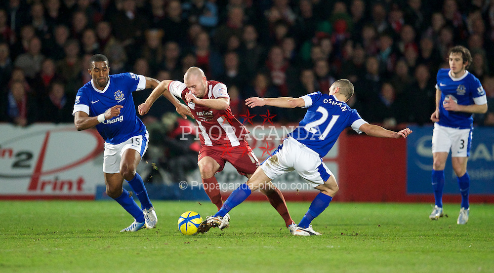 CHELTENHAM, ENGLAND - Monday, January 7, 2013: Cheltenham Town's Russell Penn is tackled by Everton's Leon Osman during the FA Cup 3rd Round match at Whaddon Road. (Pic by David Rawcliffe/Propaganda)