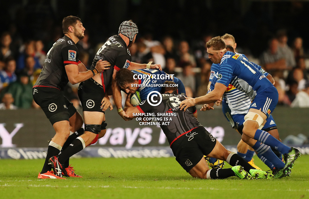 DURBAN, SOUTH AFRICA - MAY 27:  Stephan Lewies and Coenie Oosthuizen of the Cell C Sharks tackling Eben Etzebeth (vice-captain) of the DHL Stormers during the Super Rugby match between Cell C Sharks and DHL Stormers at Growthpoint Kings Park on May 27, 2017 in Durban, South Africa. (Photo by Steve Haag/Gallo Images)