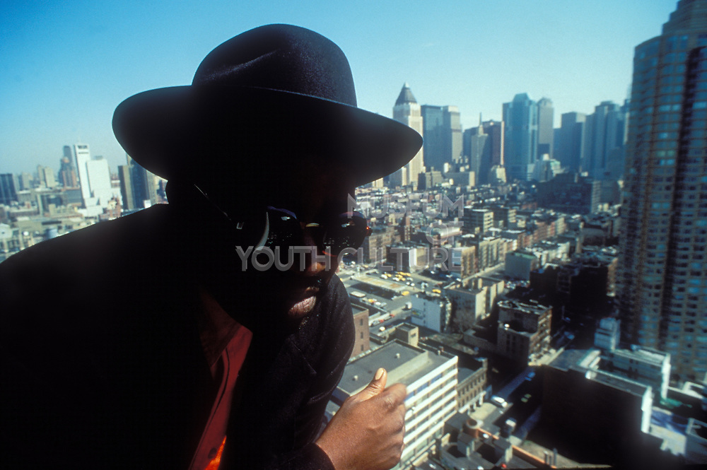 Fab Five Freddy on top of building overlooking New York, U.S.A, 1980's.