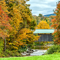 Autumn colors along the North Branch of the Lamoille River and the Church Street Covered Bridge in Waterville, Vermont.