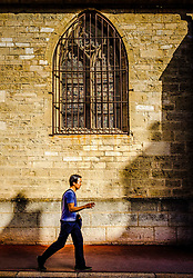 A man walks past the Notre Dame church in Beaune, Burgundy, France<br /> <br /> (c) Andrew Wilson | Edinburgh Elite media