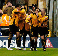 Photo: Leigh Quinnell.<br /> Wolverhampton Wanderers v Leeds United. Coca Cola Championship. 17/12/2005. Vio Ganea(second right) celebrates his goal for Wolves with his teammates.
