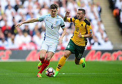 England's John Stones battles for the ball with Lithuania's Nerijus Valskis - Mandatory by-line: Alex James/JMP - 26/03/2017 - FOOTBALL - Wembley Stadium - London, England - England  v Lithuania - World Cup Qualifiers Group stage