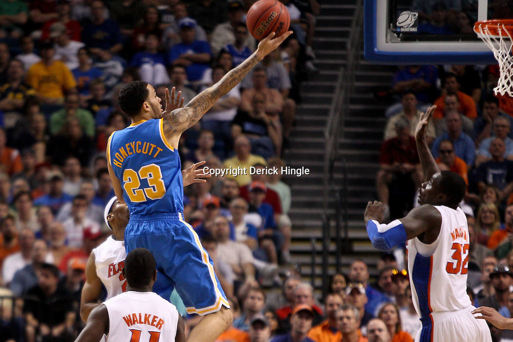 Mar 19, 2011; Tampa, FL, USA; UCLA Bruins forward Tyler Honeycutt (23) shoots over Florida Gators guard Erving Walker (11) during first half of the third round of the 2011 NCAA men's basketball tournament at the St. Pete Times Forum.  Mandatory Credit: Derick E. Hingle