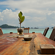 View over a wooden table around a beautiful lagoon.