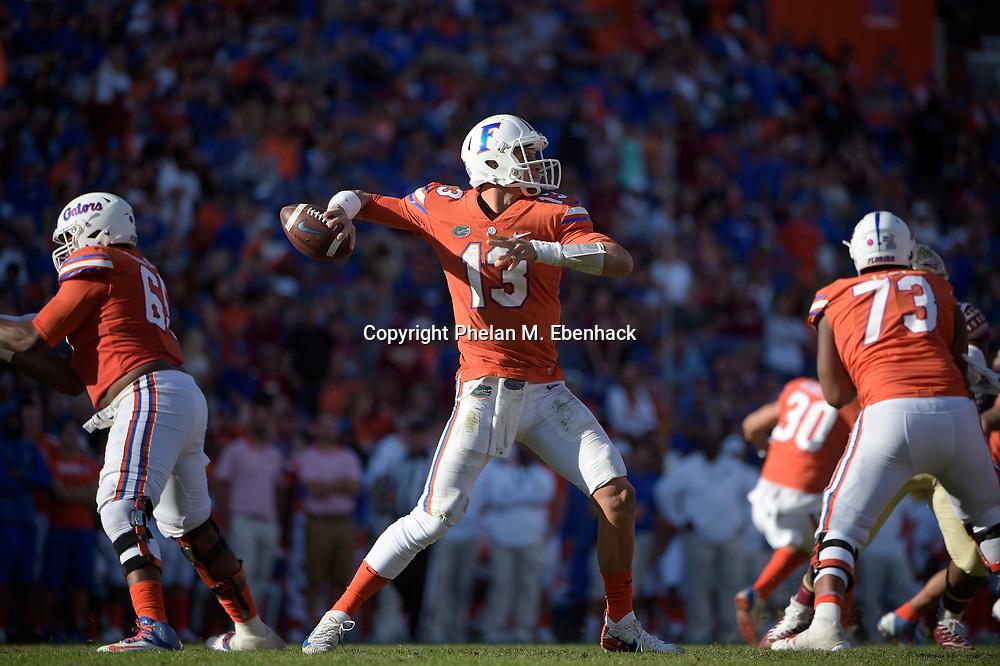 Florida quarterback Feleipe Franks (13) throws a pass during the second half of an NCAA college football game against Florida State Saturday, Nov. 25, 2017, in Gainesville, Fla. FSU won 38-22. (Photo by Phelan M. Ebenhack)
