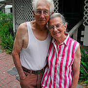 Portrait of married elderly couple in 80's, husband with in earlier stage of Alzheimer's disease in front of their house in Crescent City, FL Intimacy and sexual interactions are important to us throughout our lives.