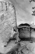 LOS ANGELES, CA:  A rock climber pits himself against a boulder problem located in the mountains behind Los Angeles, California.  The routes name is - The Sword of Damocles - and is rated V7 on the bouldering scale. (Model Released)