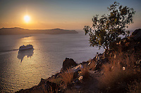 A cruise ship in the caldera at sunset, Santorini, Greece
