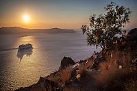 A cruise ship in the caldera at sunset, Santorini, Greece