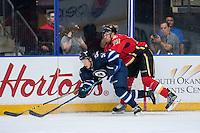 PENTICTON, CANADA - SEPTEMBER 16: Keegan Kanzig #73 of Calgary Flames checks Luke Green #51 of Winnipeg Jets on September 16, 2016 at the South Okanagan Event Centre in Penticton, British Columbia, Canada.  (Photo by Marissa Baecker/Shoot the Breeze)  *** Local Caption *** Luke Green; Keegan Kanzig;