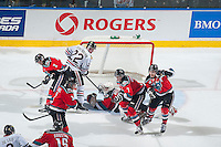 KELOWNA, CANADA - NOVEMBER 21: Jesse Lees #2, Riley Stadel #3, Tyson Baillie #24, Lucas Johansen #7 and Jackson Whistle #1 of Kelowna Rockets block the Portland Winterhawks from shooting on net on November 21, 2014 at Prospera Place in Kelowna, British Columbia, Canada.  (Photo by Marissa Baecker/Shoot the Breeze)  *** Local Caption *** Jesse Lees; Riley Stadel; Tyson Baillie, Lucas Johansen; Jackson Whistle;