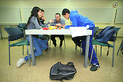 After school hours, parents tutor pupils in a public school in Israel