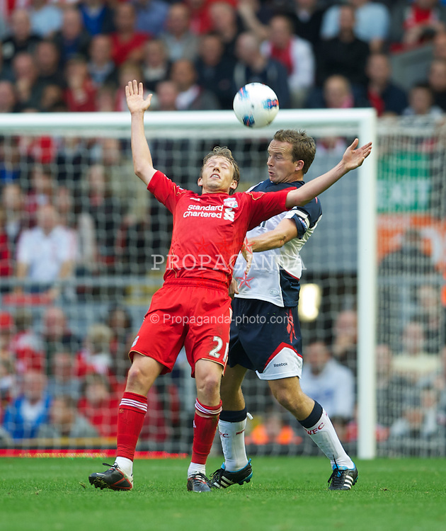 LIVERPOOL, ENGLAND - Saturday, August 27, 2011: Liverpool's Lucas Leiva in action against Bolton Wanderers' Kevin Davies during the Premiership match at Anfield. (Pic by David Rawcliffe/Propaganda)