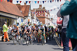 Speeding through streets lined with fans and bunting at Aviva Women's Tour 2016 - Stage 1. A 138.5 km road race from Southwold to Norwich, UK on June 15th 2016.