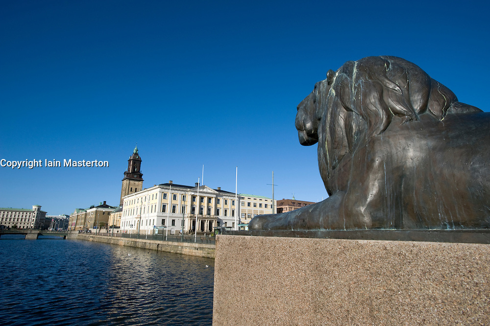 Bronze lion looking out towards Stora Hamn Canal in central Gothenburg Sweden 2008