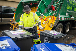 October 1, 2018 - St. Paul, MN - Minnesota, USA - Waste Management worker Daniel Westerhaus collected trash from the alleys of the Snelling Hamline neighborhood of St Paul's yellow zone on the first day of organized trash collection.        ] GLEN STUBBE • glen.stubbe@startribune.com   Monday, October 1, 2018     ....St. Paul has begun its organized trash collection, a dramatic shift in how the city collects its waste. Scattered reports of residents using the wrong bins, but so far no major snafus.   ..What's Happening at this time:  Organized trash collection. Monday, trucks are in the west side of the city, around Summit and Snelling. Jim Walsh is hitting the neighborhood now and will call in if he finds a truck. Here's a map of where the trucks will be: https://stpaul.maps.arcgis.com/apps/InformationLookup/index.html?appid=3D3a02d6d1e6cd402cbd6442a029ef8105. (Credit Image: © Glen Stubbe/Minneapolis Star Tribune via ZUMA Wire)