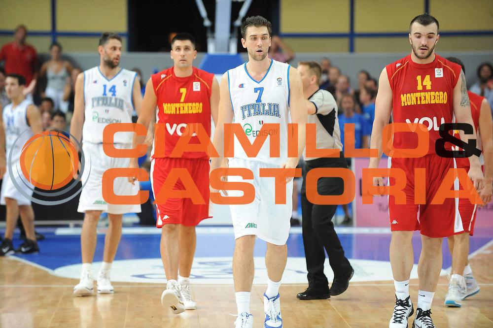 DESCRIZIONE : Bari Qualificazioni Europei 2011 Italia Montenegro<br /> GIOCATORE : Andrea Bargnani Pekovic<br /> SQUADRA : Nazionale Italia Uomini Montenegro<br /> EVENTO : Qualificazioni Europei 2011<br /> GARA : Italia Montenegro<br /> DATA : 26/08/2010 <br /> CATEGORIA : <br /> SPORT : Pallacanestro <br /> AUTORE : Agenzia Ciamillo-Castoria/GiulioCiamillo<br /> Galleria : Fip Nazionali 2010 <br /> Fotonotizia : Bari Qualificazioni Europei 2011 Italia Montenegro<br /> Predefinita :