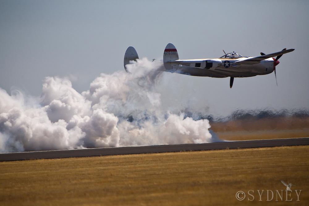 P-38Lightening races a jet car hidden in the smoke