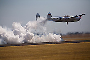 P-38Lightening races a jet car hidden in the smoke