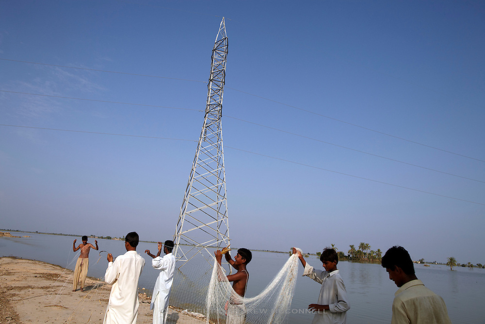 Men turn to fishing in an attempt to obtain food at the village of Sultan Kot, in Sindh Province, Pakistan.