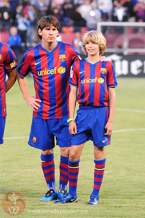 August 8, 2009; San Francisco, CA, USA; FC Barcelona forward Lionel Messi (left) before the match against Chivas de Guadalajara in the Night of Champions international friendly contest at Candlestick Park.