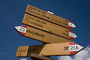 Hiking trail route signpost in the Pralongià above San Cassiano-St. Kassian in the Dolomites, south Tyrol, northern Italy. In winter, the Pralongià meadows are the heart of Alta Badia's skiing area.