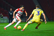 Niall Mason of Doncaster Rovers (2) takes on Danny Andrew of Doncaster Rovers (3) during the EFL Sky Bet League 1 match between Doncaster Rovers and AFC Wimbledon at the Keepmoat Stadium, Doncaster, England on 17 November 2018.