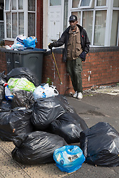 &copy; Licensed to London News Pictures. 25/07/2017. Birmingham, UK. The strike by Birmingham bin men continues as piles of rubbish in certain areas goes uncollected.<br /> Jamil Maeem who has lived in Nansen Road, Alum Rock for forty years is finding people from nearby streets are dumping their uncollected waste outside his house.  Photo credit: Dave Warren/LNP