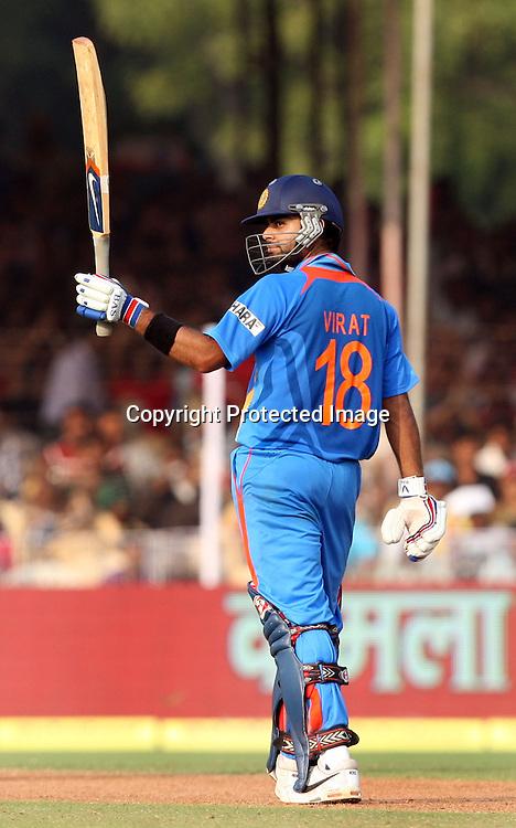 Indian Virat Kohli celebrates half century aganist New Zealand during the 3rd ODI India vs New Zealand Played at Reliance Stadium, Vadodara, 4 December 2010 (50-over match)