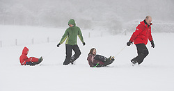 © Licensed to London News Pictures. 15/01/2013..Roseberry Topping, North Yorkshire, England..The Franks family on holiday from Worcestershire enjoy the snow...Photo credit : Ian Forsyth/LNP