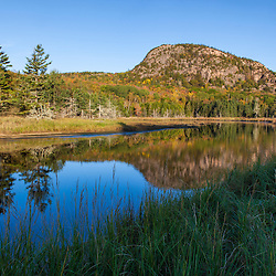 """The Beehive"" reflects in a tidal creek in Maine's Acadia National Park."
