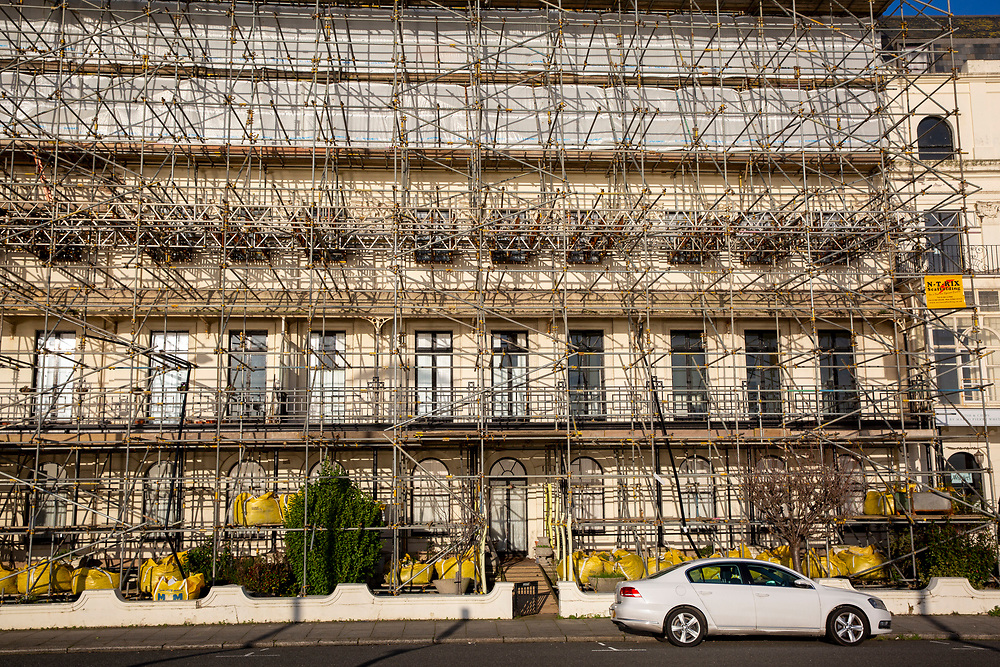 Scaffolding completely surrounds a building at a construction site on Waterloo Crescent in Dover, Kent on the 29th of January 2020. The seafront building is being completely renovated and is covered top to bottom in scaffolding.  (photo by Andrew Aitchison / In pictures via Getty Images)