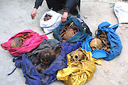 Man Digs Grave And Sells Bones For Ghost Marriage<br /> <br /> The image shows Yang Jinyu, a peasant from Xinghuo Village with the six skeletons of adult female he stolen to sell for ghost marriage on March 28, 2005 in Xi'an, Shaanxi Province of China. Yang Jinyu, a peasant from Xinghuo Village in Shaanxi digged several graves and collected six skeletons of adult female from his village after hearing that a skeleton could be sold for up to 300 to 500 RMB (about 48 to 80 USD) for ghost marriage when he worked in Shanxi. But on Yang's way to Shanxi, he was suspected and caught by policeman at Xi'an Railway Station on March 28, 2005. <br /> ©Exclusivepix Media