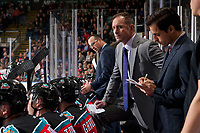 KELOWNA, CANADA - OCTOBER 13: Kelowna Rockets' coaches Travis Crickard, Jason Smith and Kris Mallette stand on the bench against the Calgary Hitmen on October 13, 2017 at Prospera Place in Kelowna, British Columbia, Canada.  (Photo by Marissa Baecker/Shoot the Breeze)  *** Local Caption ***