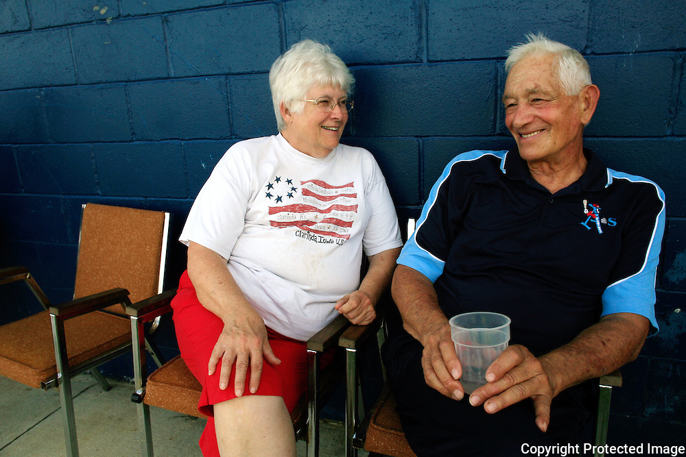 Pat and Merle Eberly found a shady spot to relax on a hot sticky day last summer at Municipal Stadium in Clarinda, where the baseball team that they run, the Clarinda A's were playing in a post season tournament.  Pat is the center of the operation - lining up the housing program for the players, scheduling transportation and taking care of the business side of the team.  Merle is the soul - a man who has lived and breathed baseball his whole life.  He played when the A's were a town team and also managed.