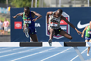 Jul 27, 2019; Des Moines, IA, USA; Hillary Bor defeats Stanley Kebenei to win the steeplechase, 8:18.05 to 8:19.12,  during the USATF Championships at Drake Stadium.