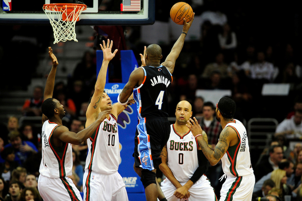 Jan. 21, 2011; Cleveland, OH, USA; Cleveland Cavaliers power forward Antawn Jamison (4) shoots over Milwaukee Bucks small forward Luc Richard Mbah a Moute (12) small forward Carlos Delfino (10) power forward Drew Gooden (0) and small forward Chris Douglas-Roberts (17) during the third quarter at Quicken Loans Arena. The Bucks beat the Cavaliers 102-88. Mandatory Credit: Jason Miller-US PRESSWIRE