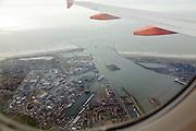 flying over the harbor of IJmuiden Holland seen from an Easyjet passenger airplane