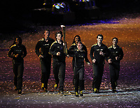 Olympics - London 2012 - Opening Ceremony<br /> The young athletes nominated to light the flame carry the torch round the stadium during the opening ceremony