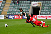 Graham Carey (10) of Plymouth Argyle is rugby tackled by Janoi Donacien (30) of Accrington Stanley during the EFL Sky Bet League 2 match between Plymouth Argyle and Accrington Stanley at Home Park, Plymouth, England on 1 April 2017. Photo by Graham Hunt.