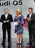 (L-R) Audi's managing director - Joerg Hofmann, Sandra Sully, Todd Woodbridge.Media Preview .Melbourne International Motorshow.Melbourne Exhibition Centre.Clarendon St, Southbank, Melbourne .Friday 27th of February 2009.(C) Joel Strickland Photographics.