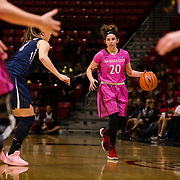 10 February 2018: The San Diego State Aztecs women's basketball team hosts Nevada on Play4Kay day at Viejas Arena. San Diego State Aztecs guard Geena Gomez (20) brings the ball up the court against Nevada Wolf Pack in the second half. The Aztecs beat the Wolfpack 75-72. <br /> More game action at www.sdsuaztecphotos.com