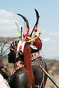 Kenya, Masai Mara, Masai (Also Maasai) Tribesmen an ethnic group of semi-nomadic people. Warriors with traditional headdress and ochre