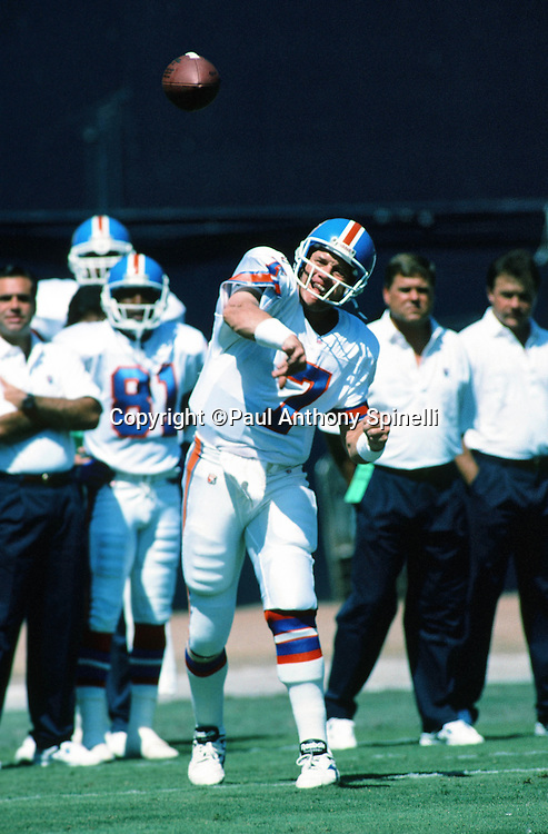 Denver Broncos quarterback John Elway (7) throws a pass during pregame warmups before the NFL football game against the San Diego Chargers on Sept. 24, 1995 in San Diego. The Chargers won the game 17-6. (©Paul Anthony Spinelli)