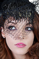 Close-up of elegant woman wearing veil